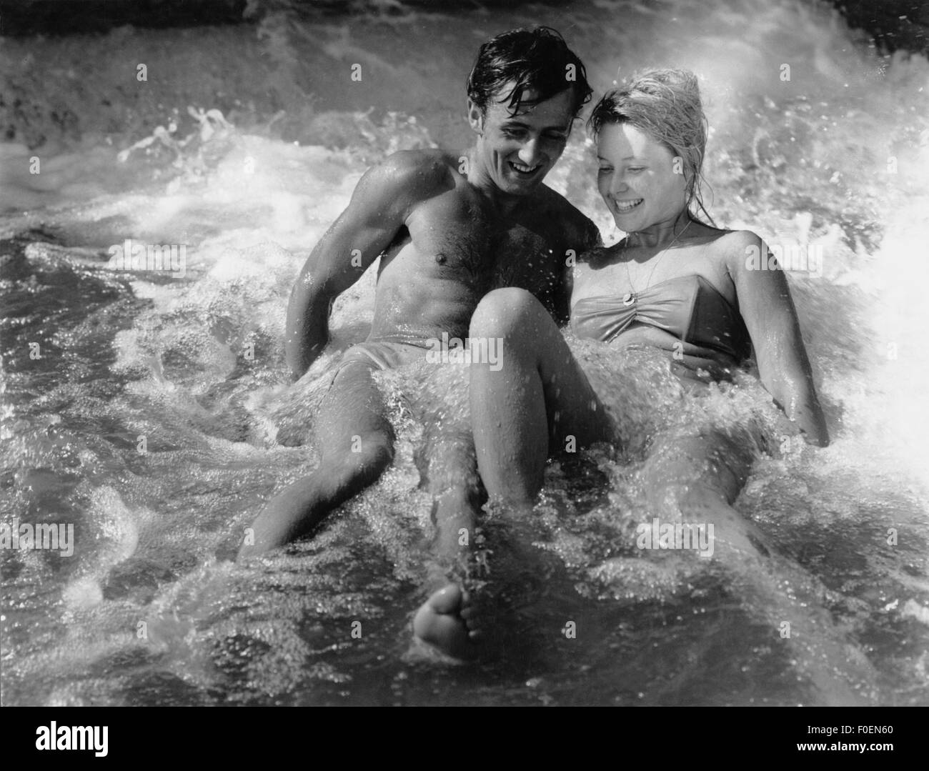 people, couples, lovers / romanticism, young couple in the surf, 1960s, Additional-Rights-Clearences-NA - Stock Image