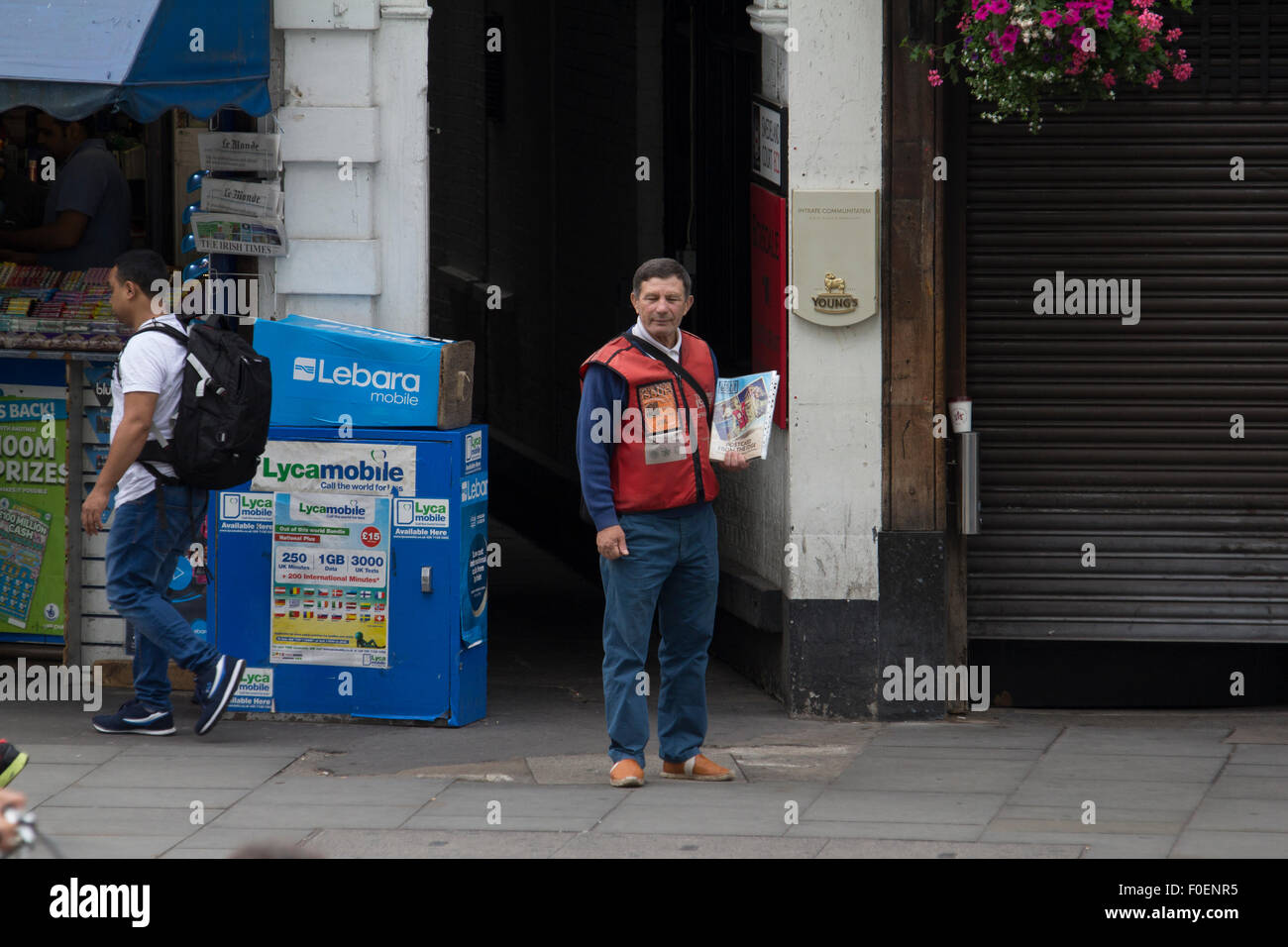 Big Issue magazine seller in central London - Stock Image