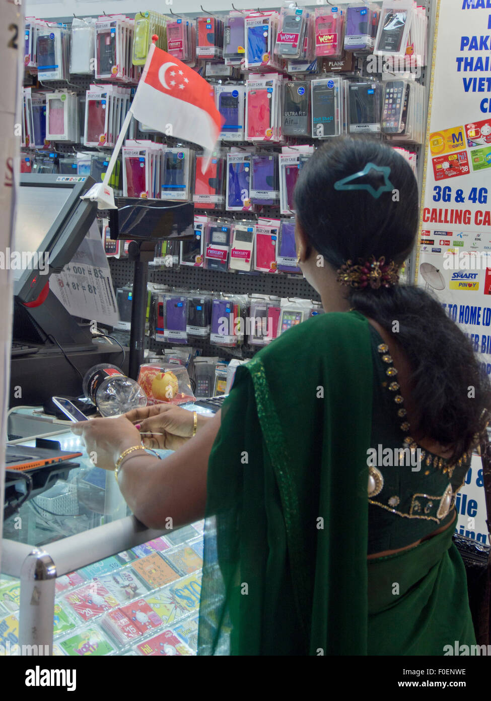 Indian woman at a mobile phone shop in the Tekka Centre