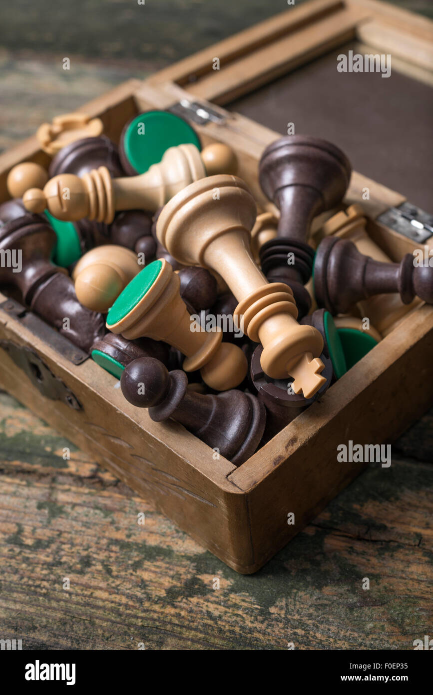 chessmen on a wood box on an old table - Stock Image