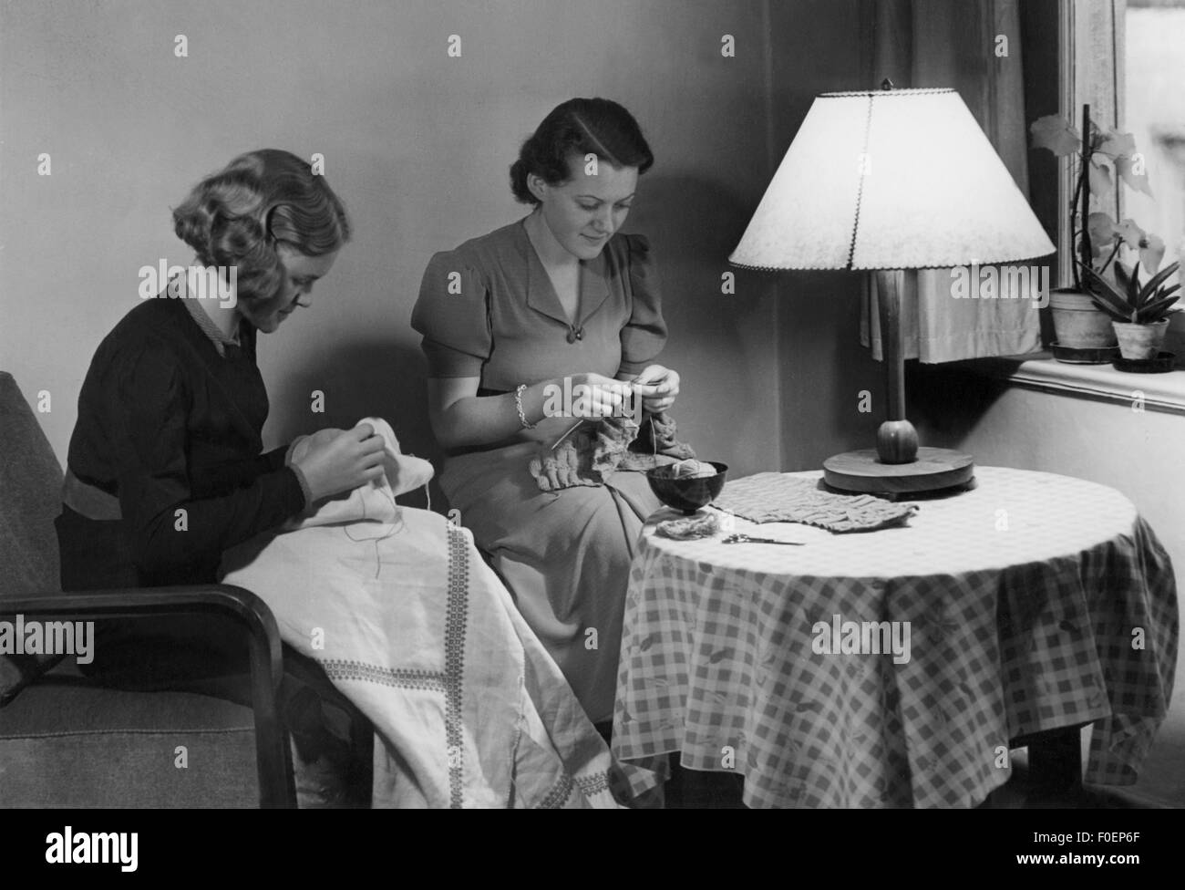 household, needlework, two women sewing and knitting, 1930s, Additional-Rights-Clearences-NA - Stock Image