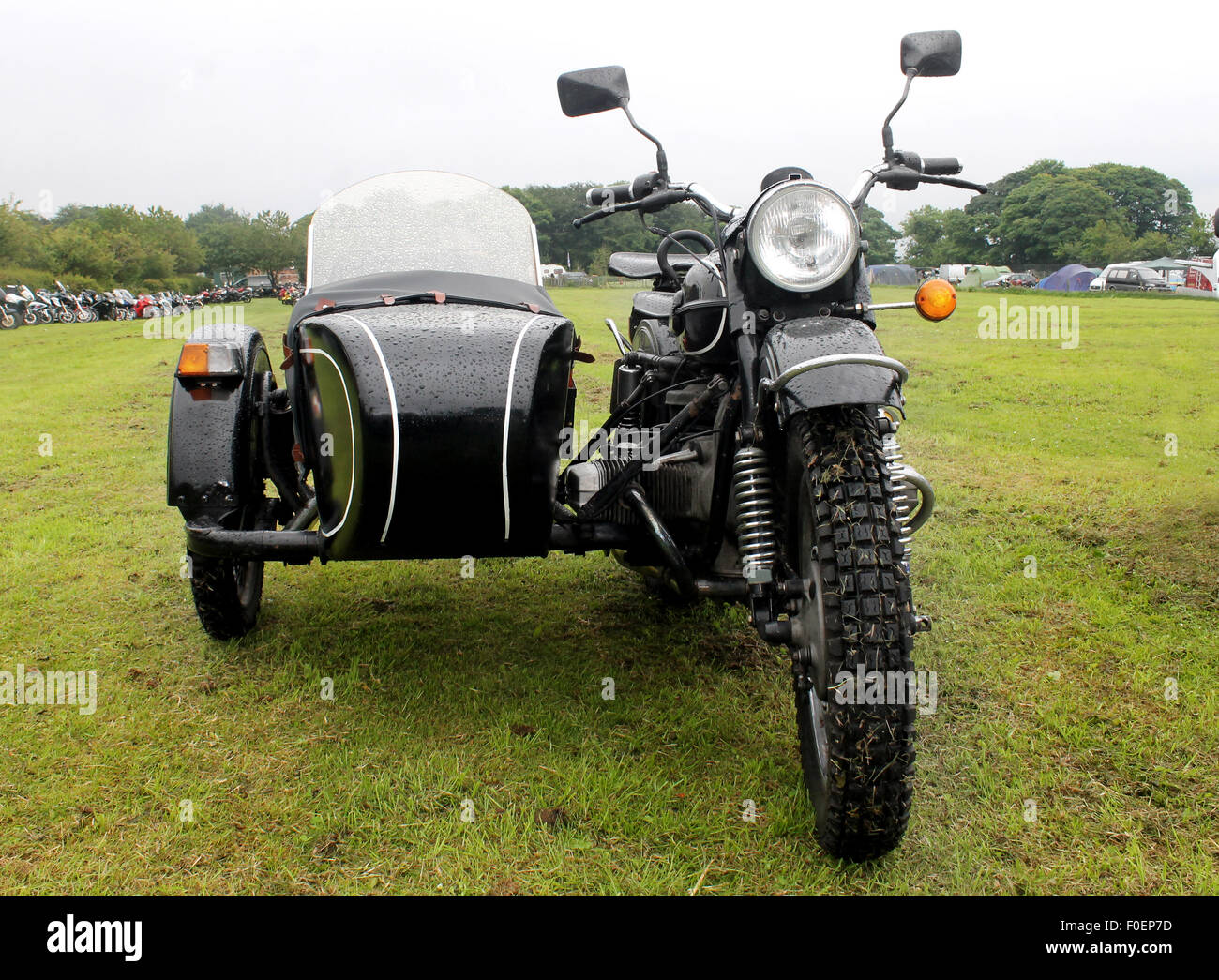 Motorbike and sidecar in a countryside field. - Stock Image