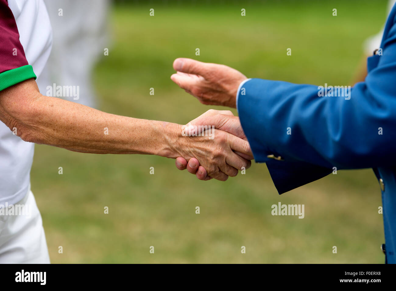 People shaking hands - Stock Image
