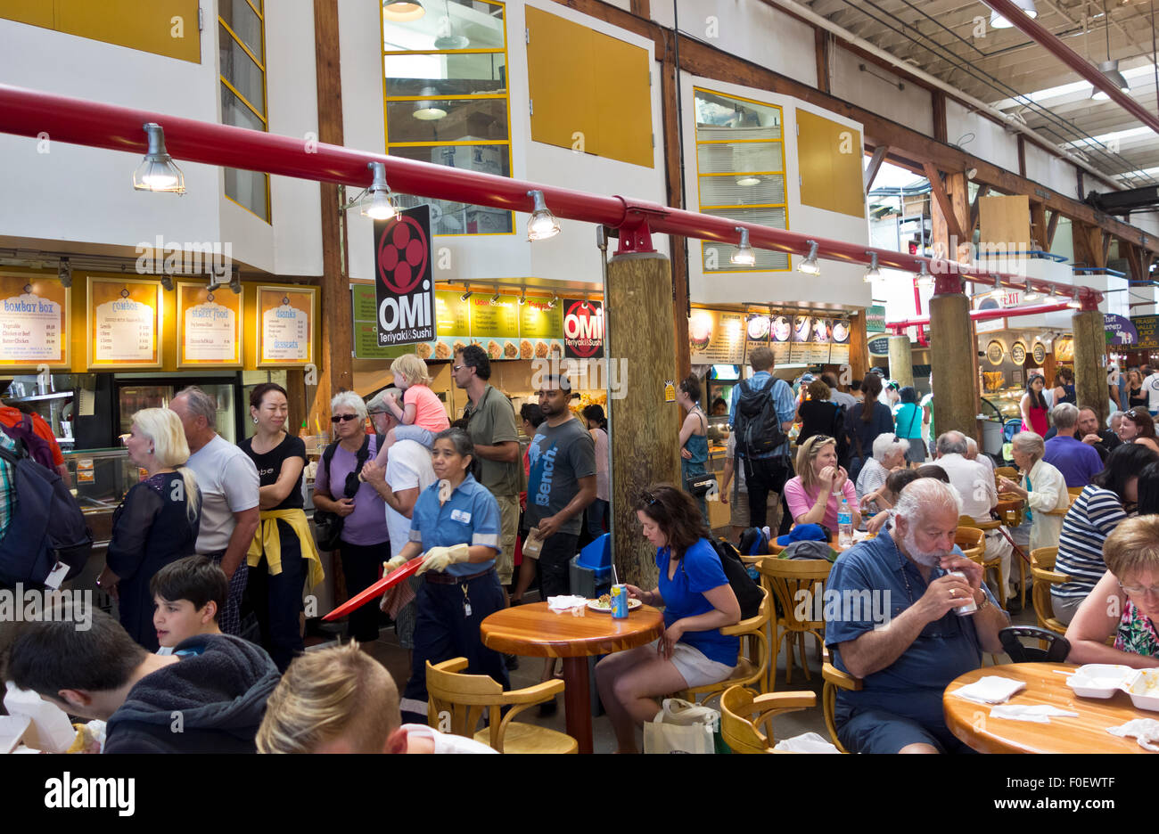 Granville Island Public market food court in Vancouver, BC, Canada. People eating from local restaurants. - Stock Image
