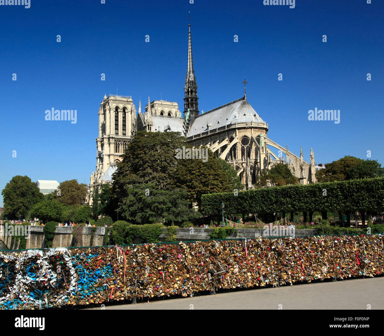 Notre Dame de Paris with a padlock lined bridge in the foreground. Paris, France, Europe - Stock Image