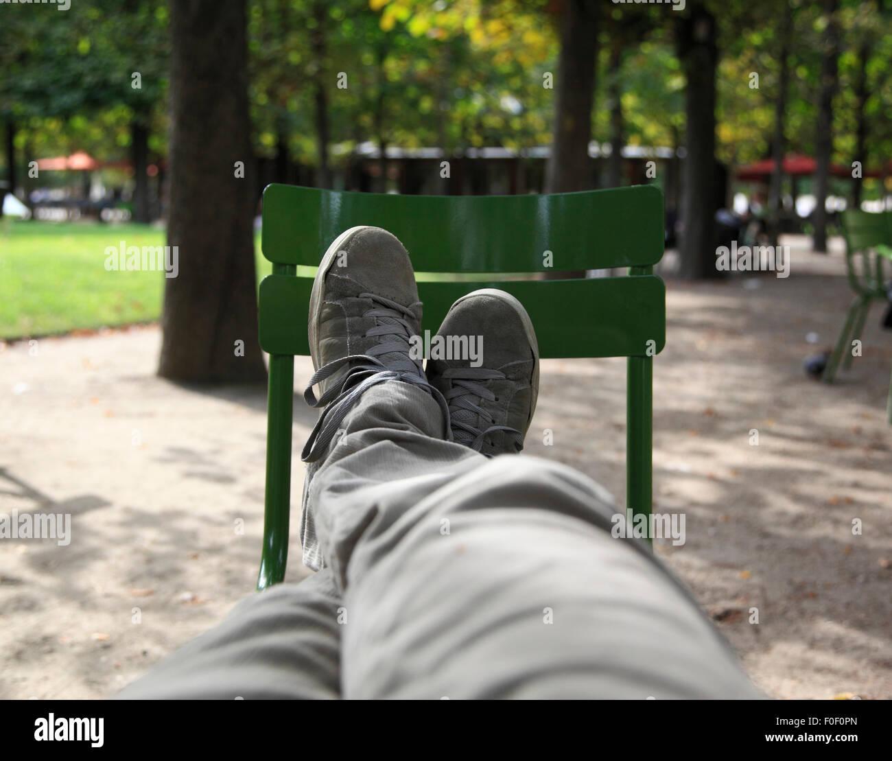 Feet up in a Parisian park, Paris, France, Europe - Stock Image