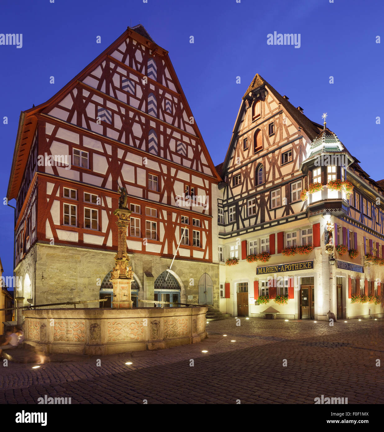 typical medieval buildings with George's Spring, Rothenburg ob der Tauber, Franconia, Bavaria, Germany - Stock Image