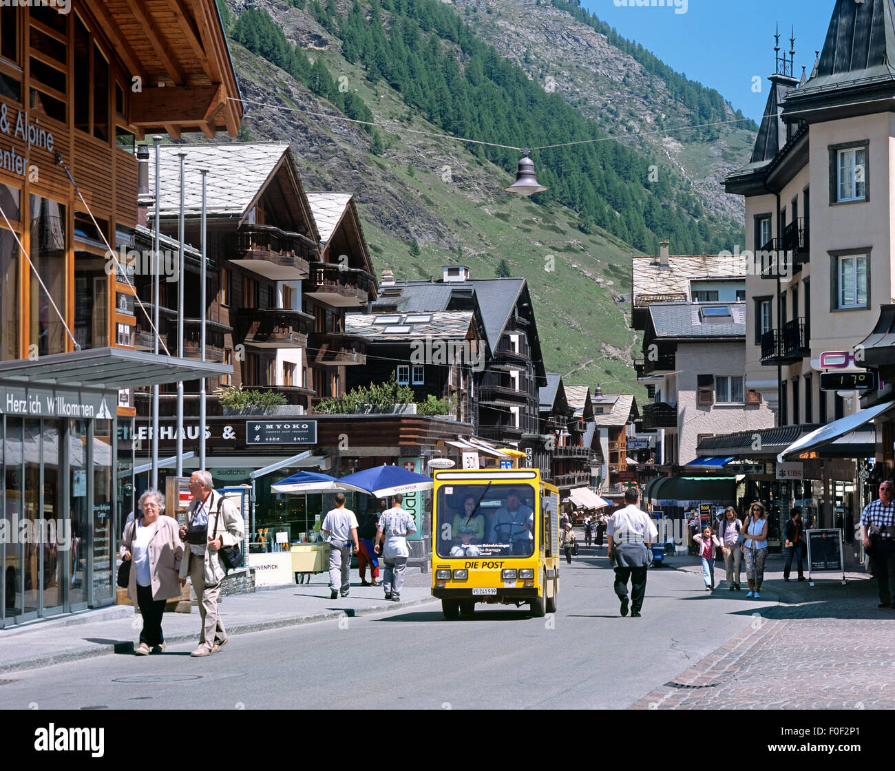 A battery-powered electric postal delivery van in Bahnhofstrasse in the 'car-free' town centre of Zermatt, - Stock Image