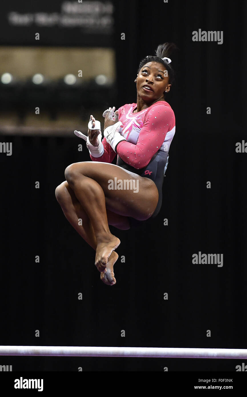 Aug. 13, 2015 - Indianapolis, Indiana, U.S - World Champion SIMONE BILES dismounts from the uneven bars as she finished Stock Photo