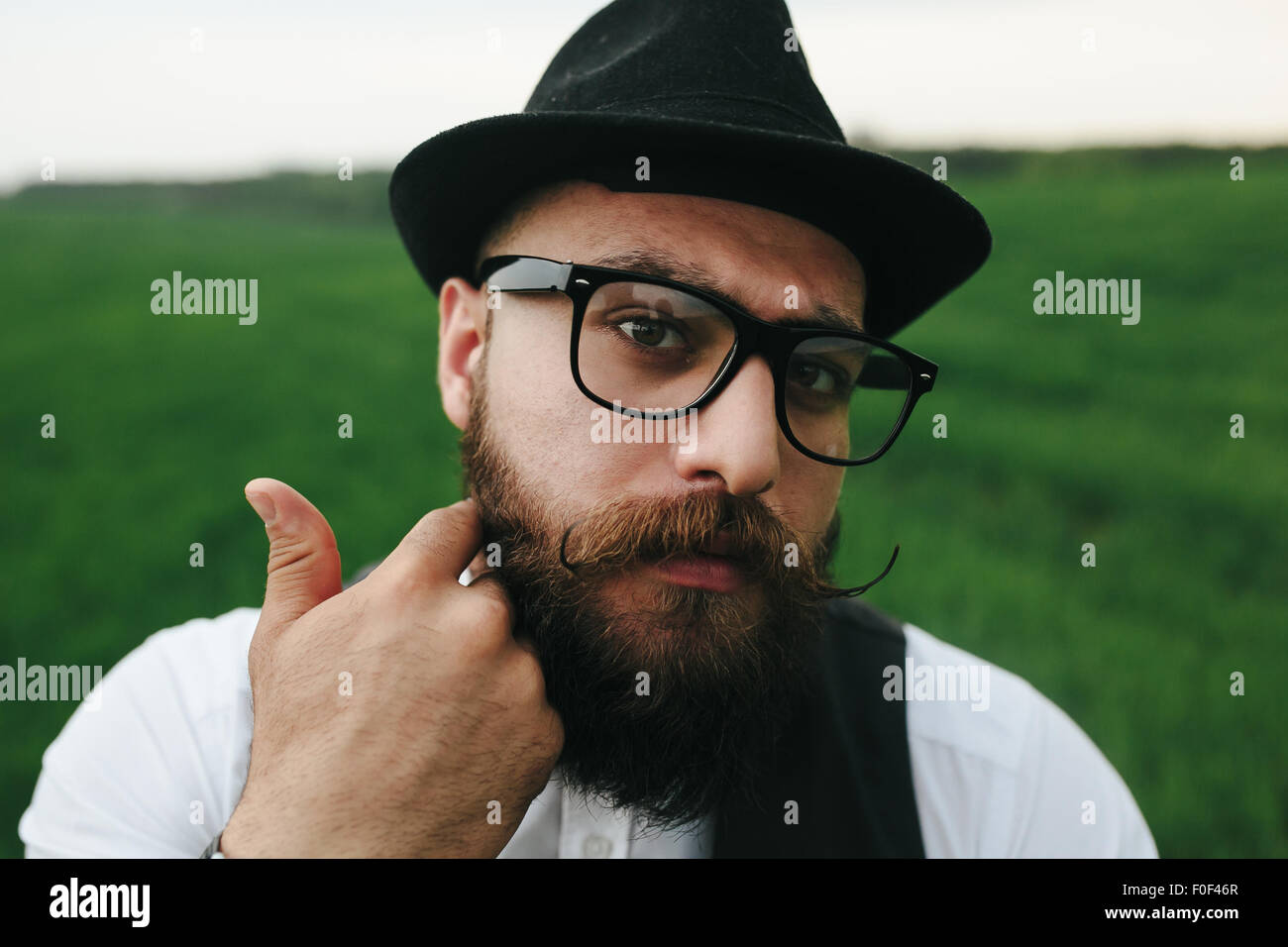 man with a beard, thinking in the field - Stock Image
