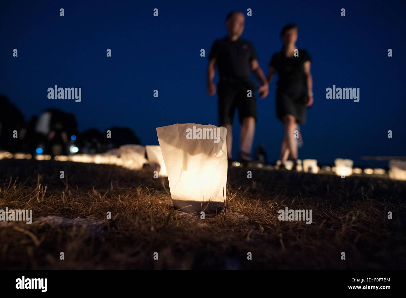 Visitors walk thorough the labyrinth of lights at Tempelhofer Feld in Berlin, Germany, 13 August 2015. Here, Theater - Stock Image