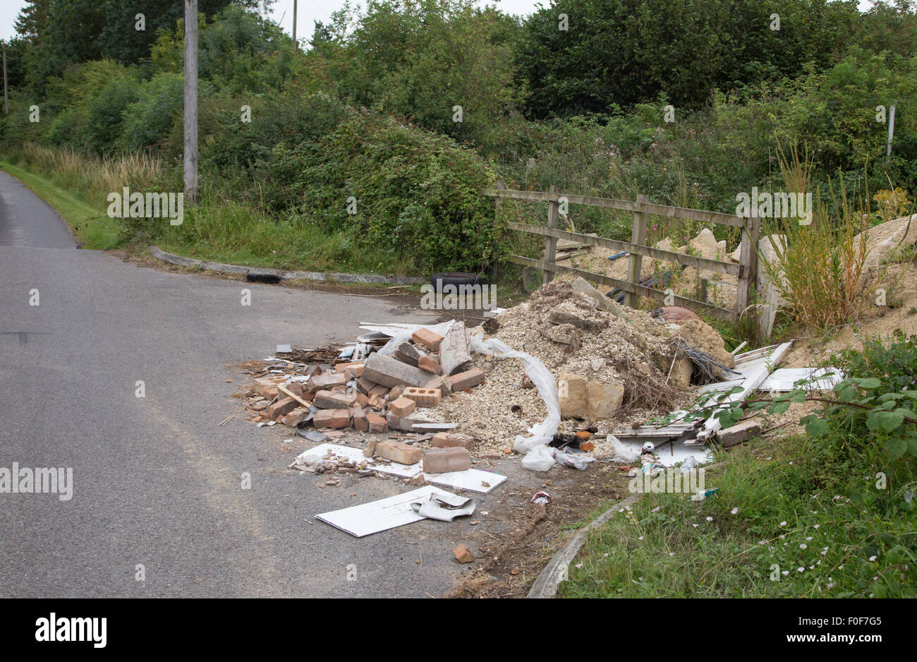 Fly-tipping in a country lane, England, UK - Stock Image