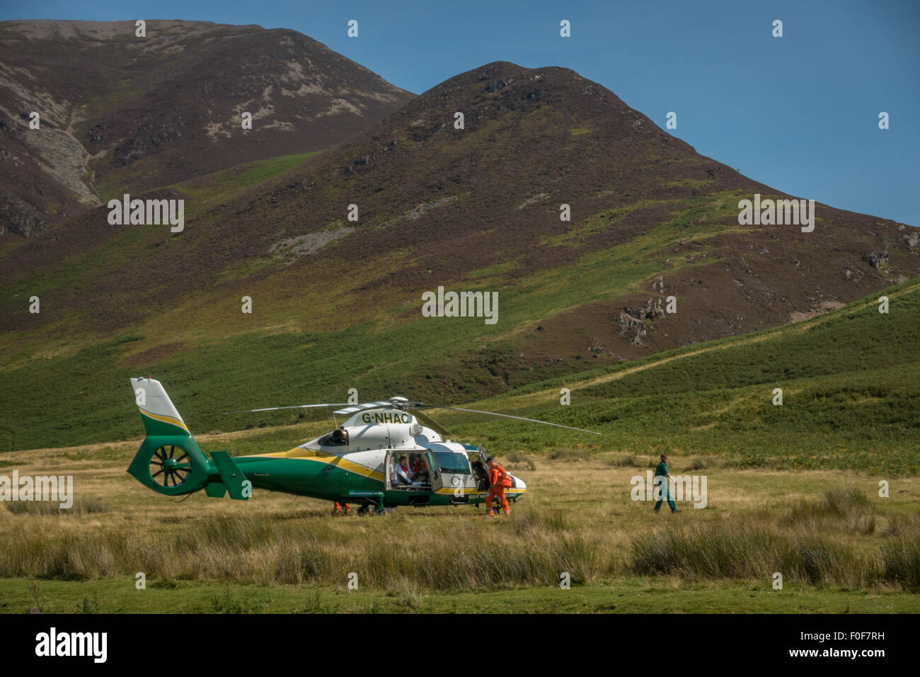 Great North Air Ambulance with a patient in the helicopter - on call in Buttermere, Cumbria. - Stock Image