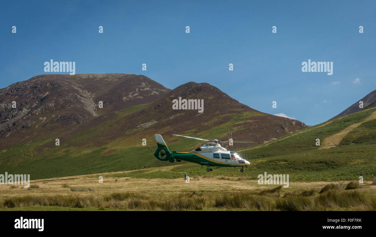 Great North Air Ambulance, on a call in Buttermere, Cumbria. - Stock Image