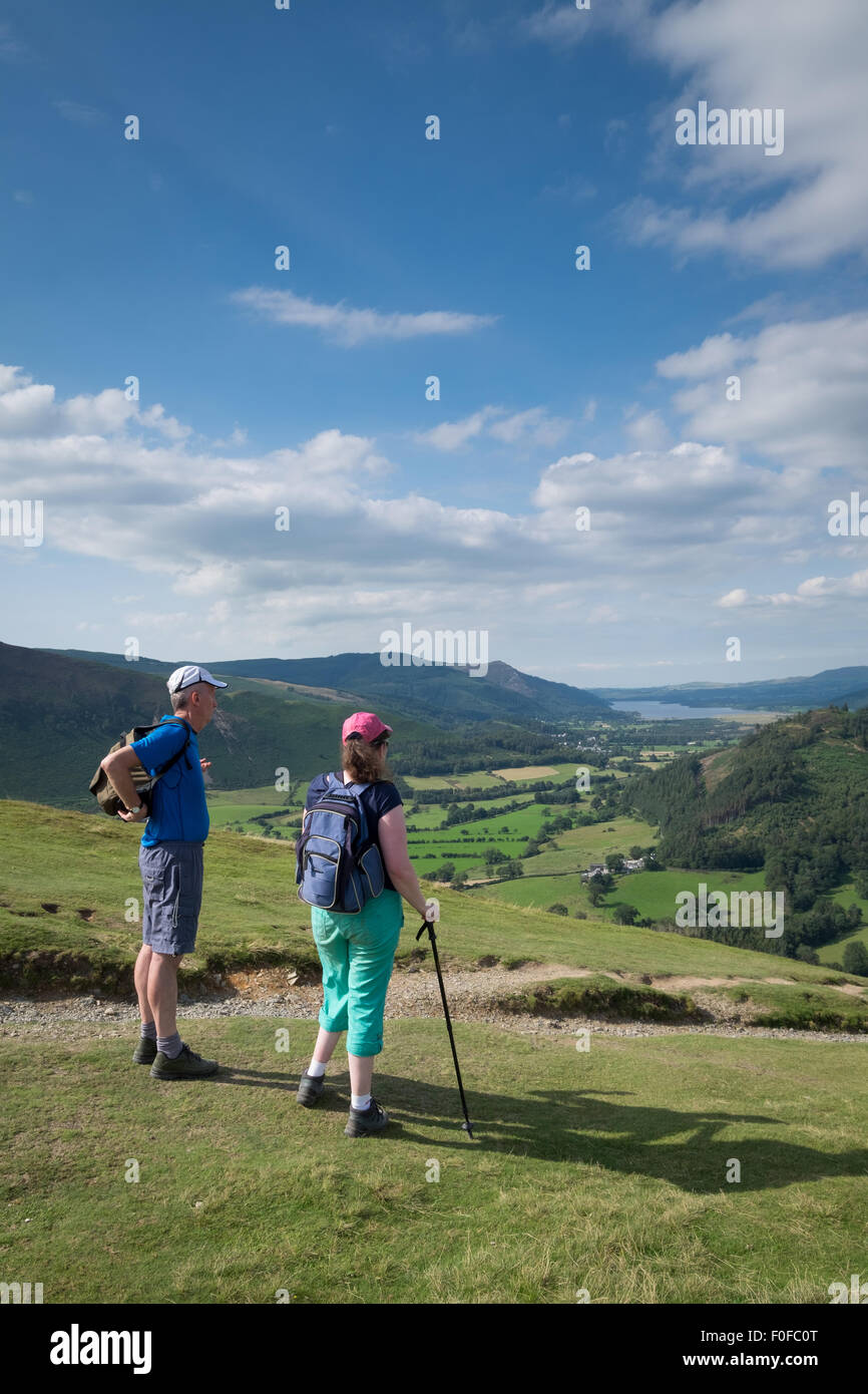 Trekkers take in the view from Catbells fell near Keswick in the Lake District - Stock Image