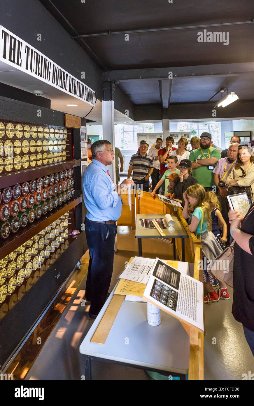 Visitors listening to a talk about the rebuilt Turing Bombe codebreaking machine, Bletchley Park, Buckinghamshire, Stock Photo