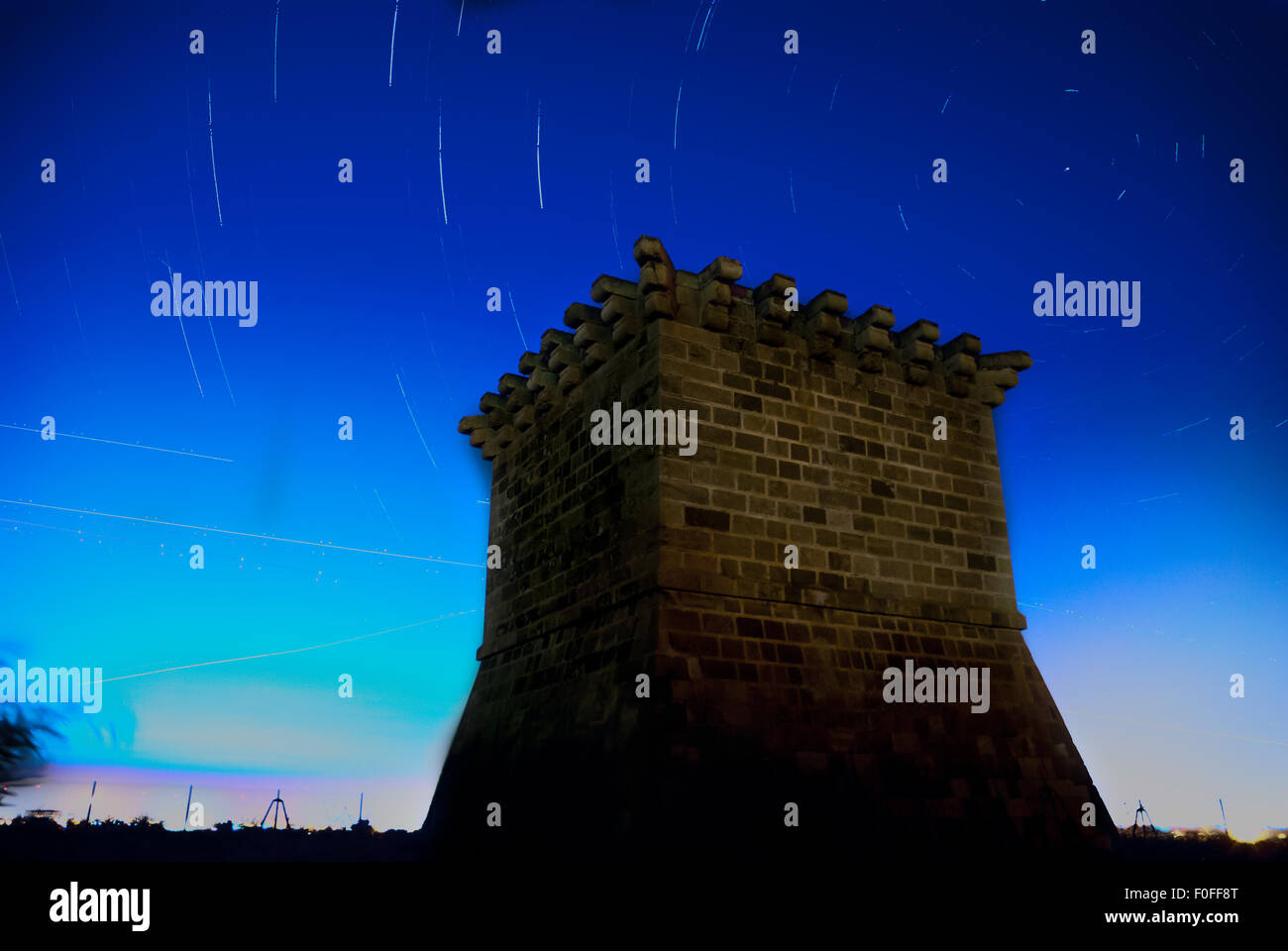 Medieval venetian watchtower at Kiti with night sky with star tracks as a background. Larnaca. Cyprus - Stock Image