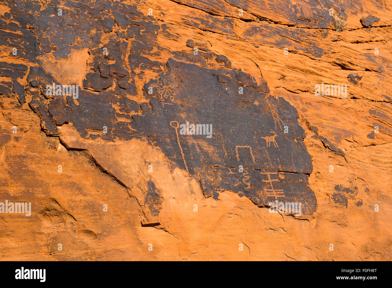 Ancient rock art and carving in Valley of Fire State Park, South Nevada - Stock Image