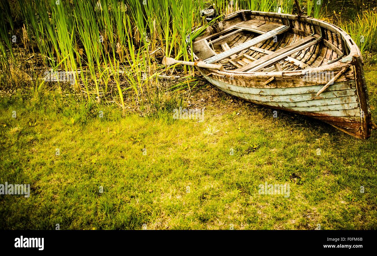 waters recede, and the ground devours the surface around this once adored boat that holds so many memories. But - Stock Image