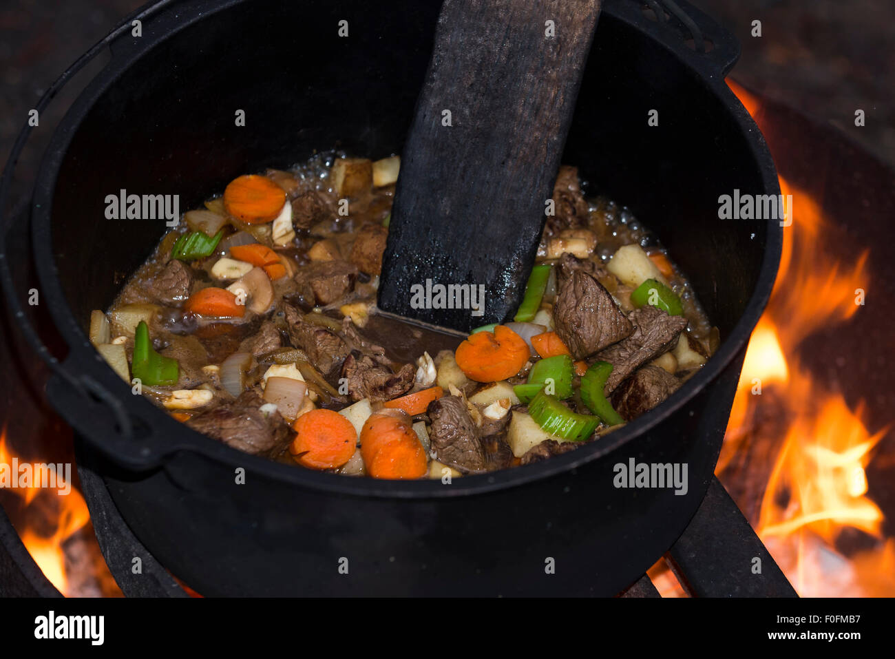 Beef Stew Cooking In A Cast Iron Dutch Oven Over An Open Campfire Stock Photo Alamy