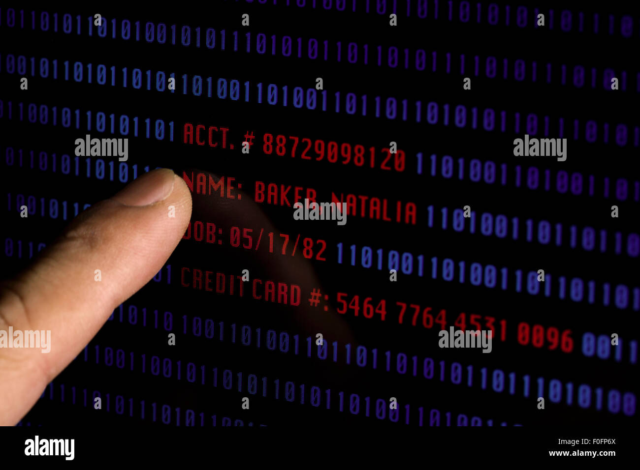 Man pointing to personal and sensitive information on computer screen (information is fictional) - Stock Image
