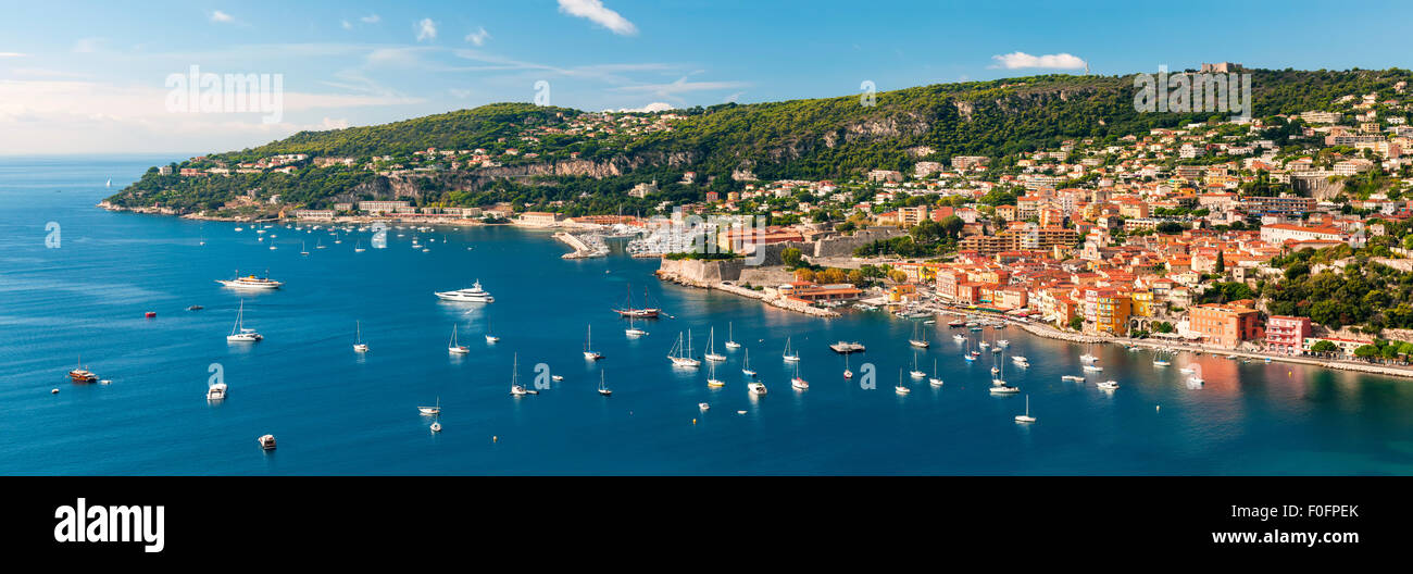 Panoramic aerial view of French Riviera coast at Villefranche-sur-Mer harbour and Cap de Nice with leisure boats - Stock Image