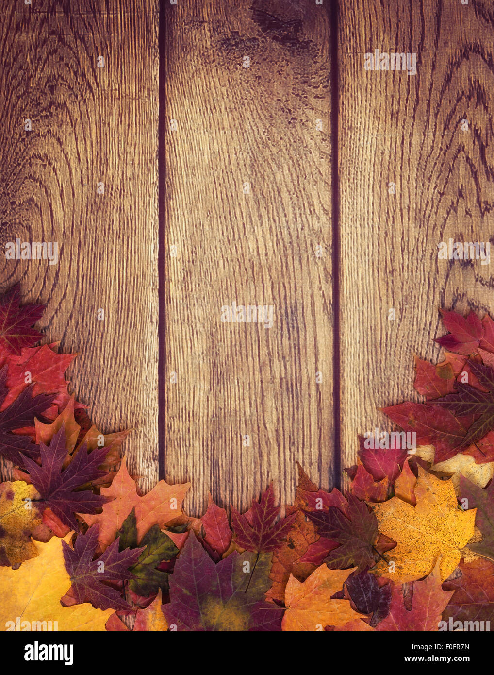 autumn leaves border against wooden background stock photo 86399369