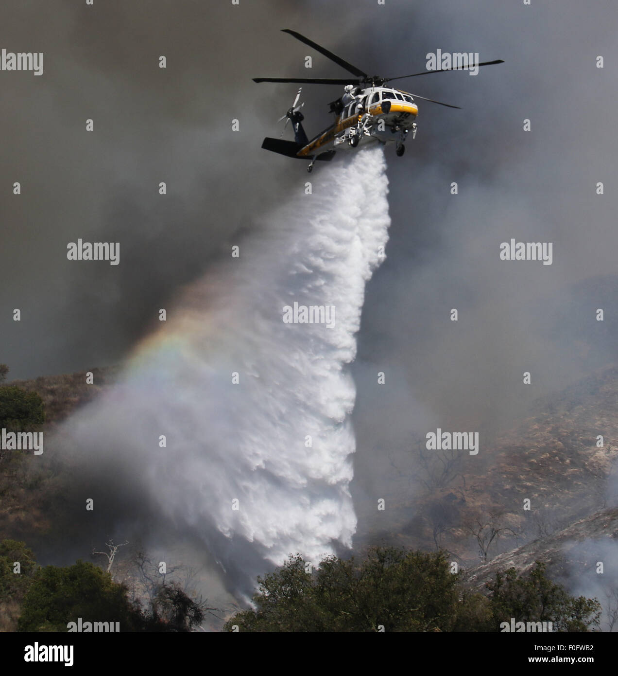 Simi Valley CA. 14th Aug, 2015. Firefighters battle a 180  acre brush fire in the Wood Ranch area of Simi Valley - Stock Image