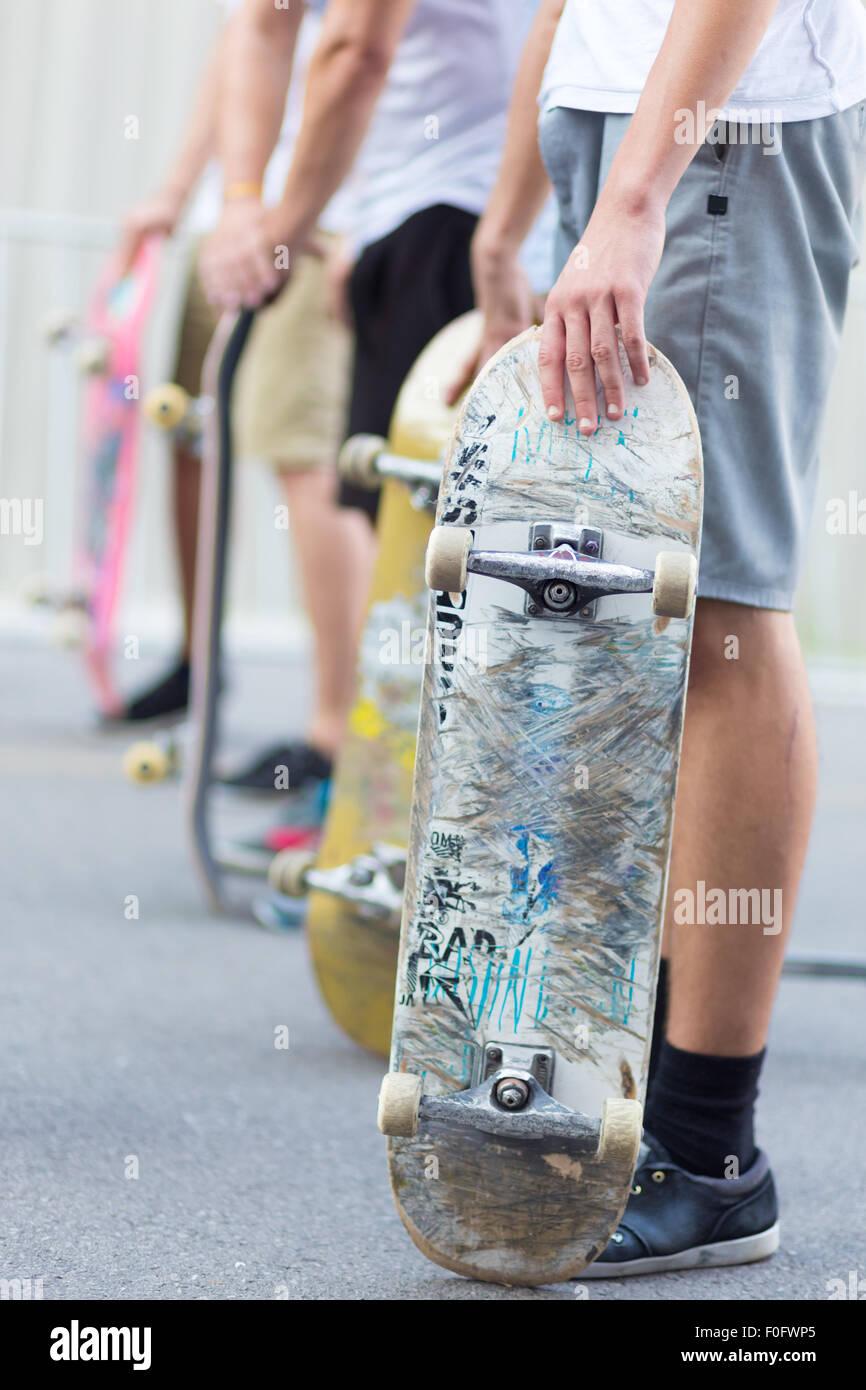 Boys skateboarding on street. Urban life. - Stock Image