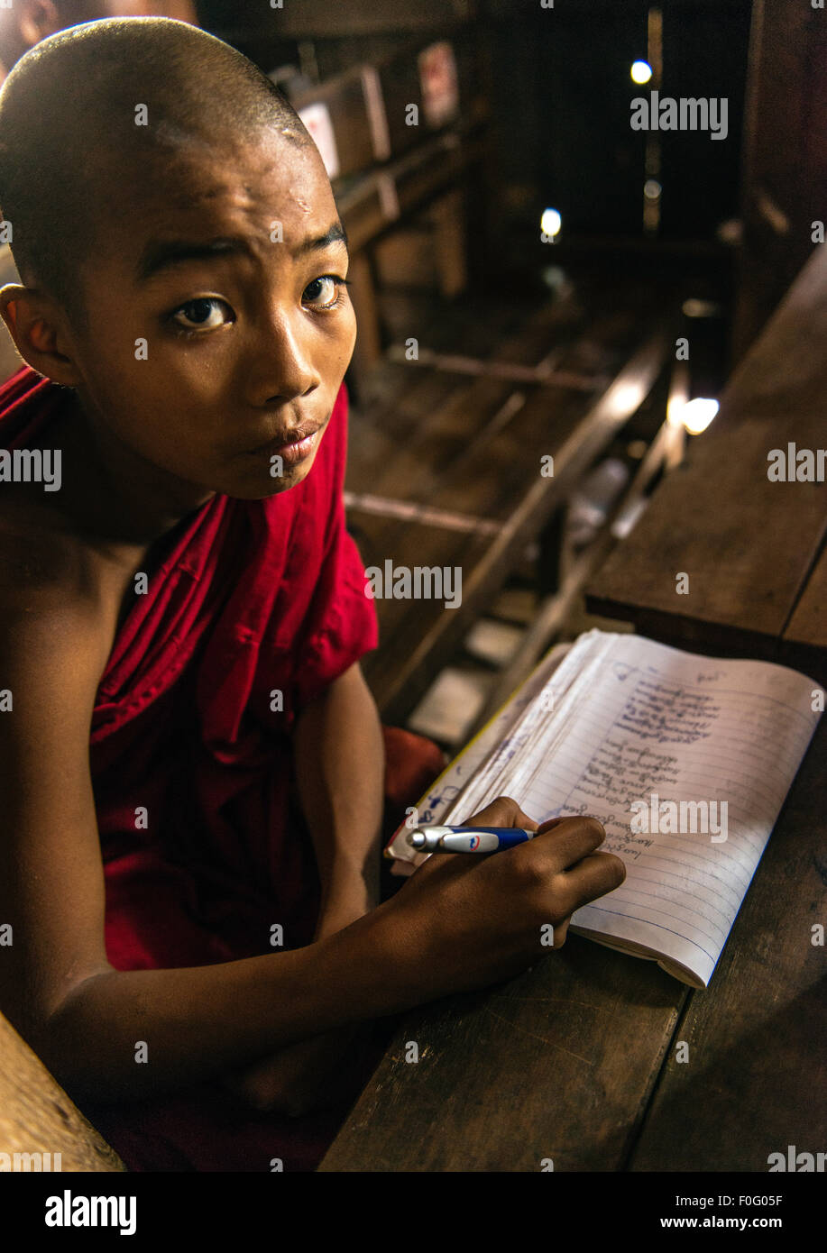 Young monk studying monastery near Mandalay Myanmar Burma - Stock Image