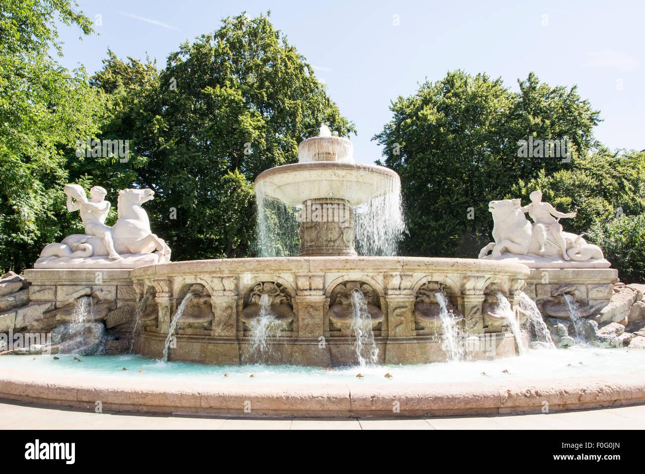 The Wittelsbacher Brunnen at the Lenbachplatz in Munich. The fountain was built 1895 by Adolf von Hildebrand. - Stock Image