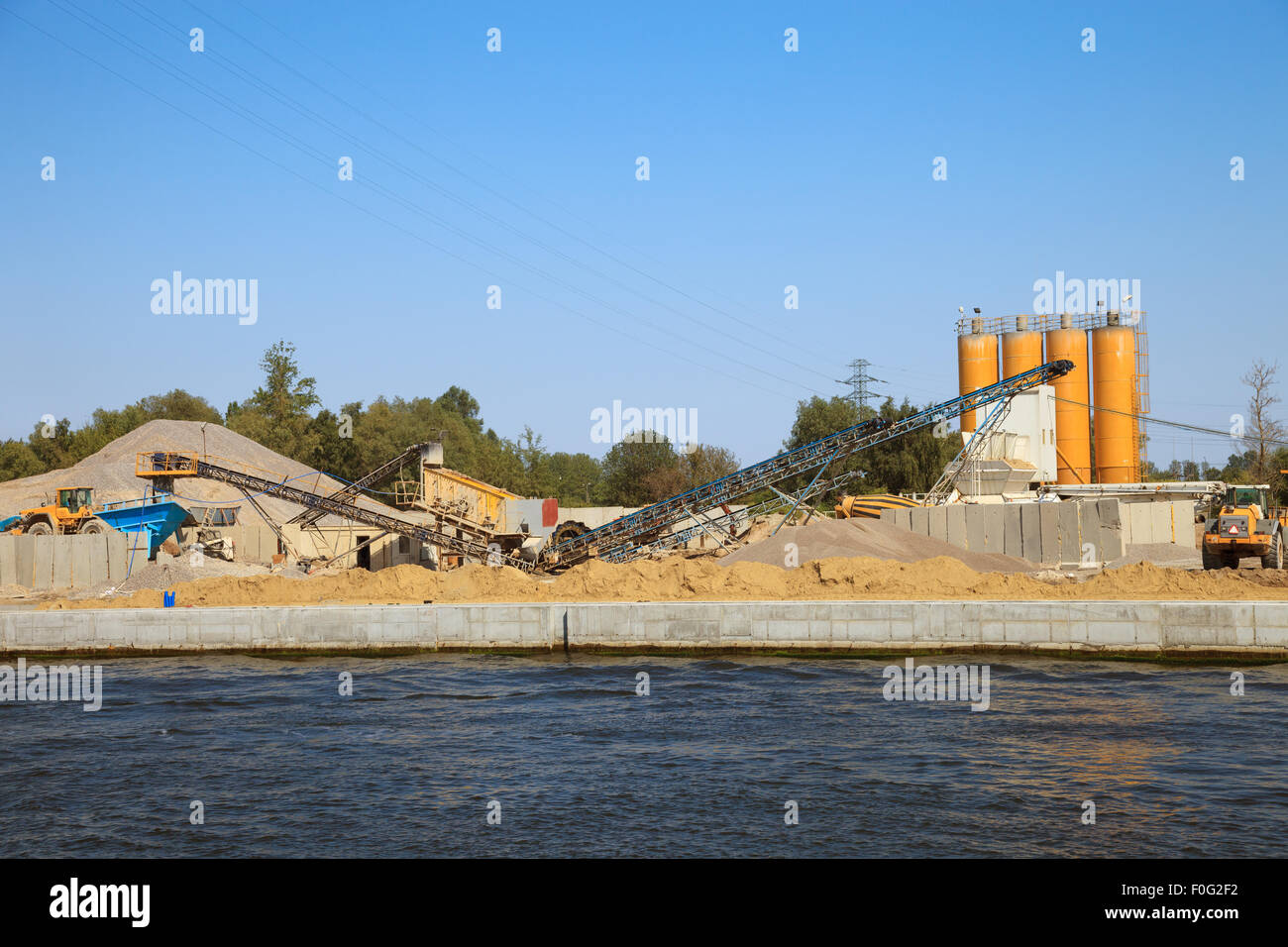 Construction work of new quay in port. - Stock Image