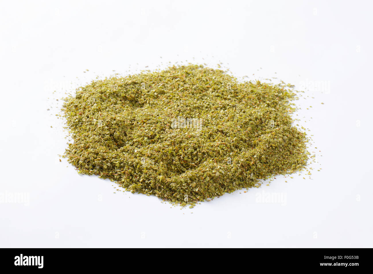 Heap of dried Marjoram leaves - Stock Image