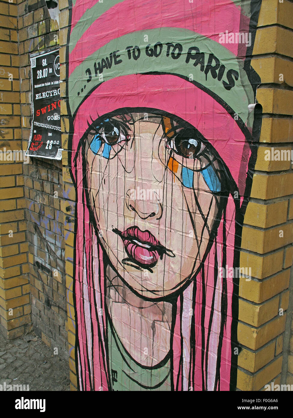 Girl Grafitti on a Berlin wall,street,art,Germany - I have to go to Paris in pink - Stock Image