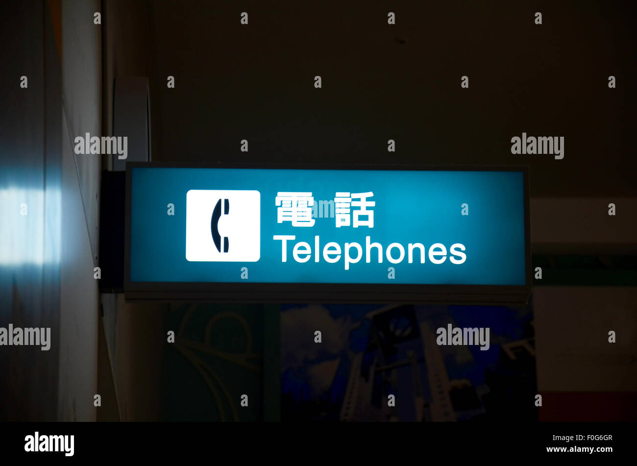 Public telephone label in Kansai Airport of Japan - Stock Image
