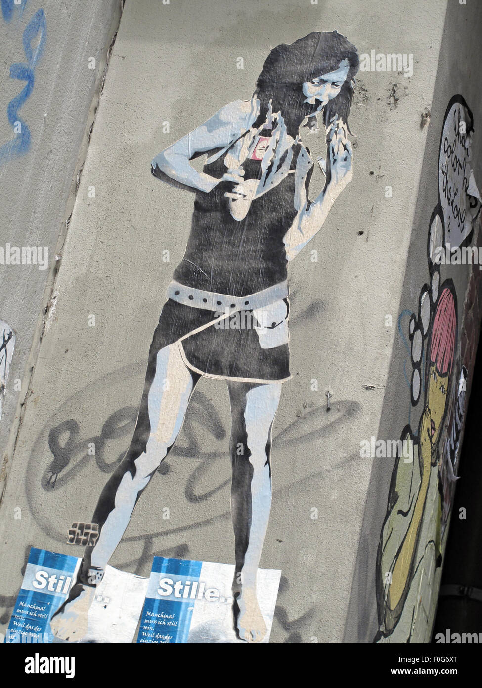 Berlin Mitte,Street art on walls,Germany- Drinking beer from a bottle,eating - Stock Image