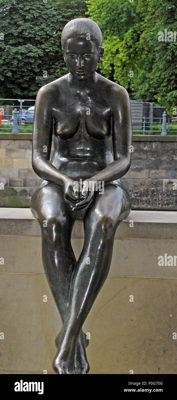 Three girls and a boy by Wilfried Fitzenreiter - Statue by the Spree River, Moabit, Berlin, Germany, frontal view - Stock Image