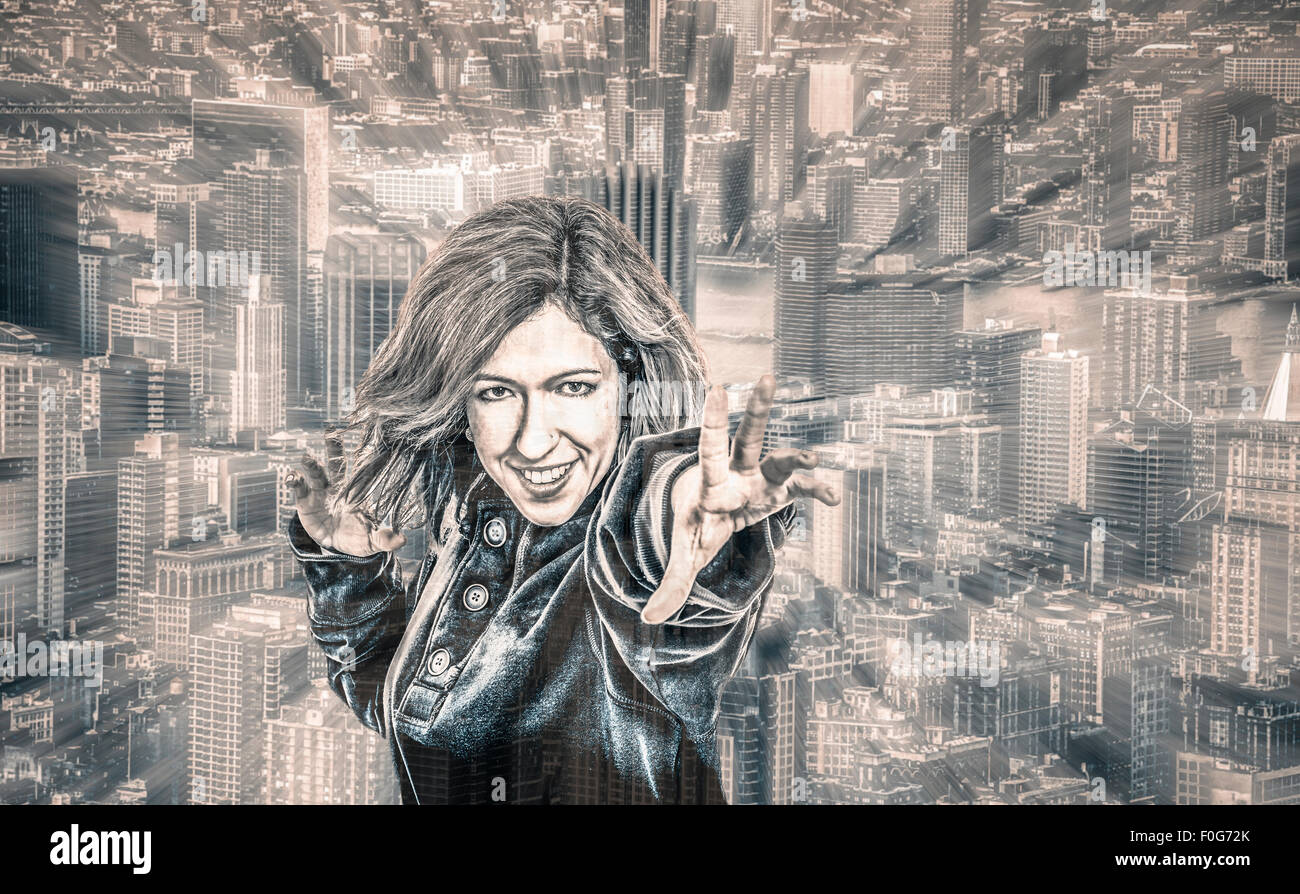 Female superhero and cityscape on the background, digitally altered portrait with motion blur effect. Stock Photo