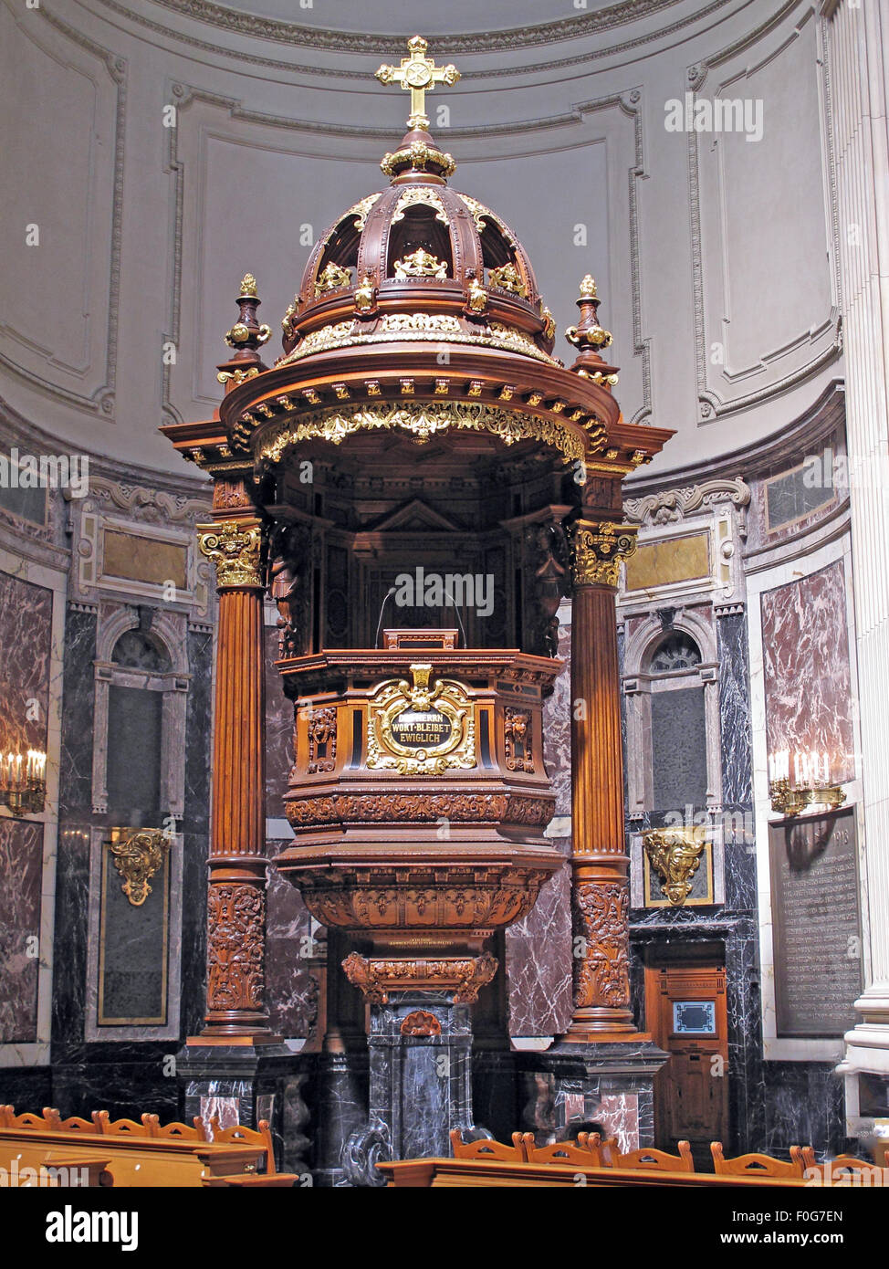 Pulpit in the Berlin Cathedral Pulpit c1905, Germany; Wood and gold design with crucifix. Stock Photo