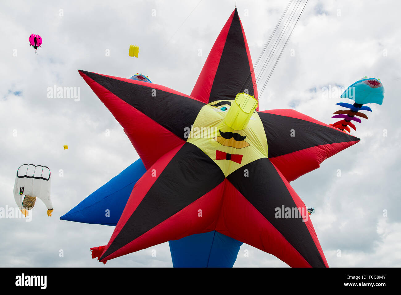 Portsmouth, UK. 15th August 2015. A large star shaped kite flies at the International Kite Festival. Credit:  MeonStock/Alamy Stock Photo