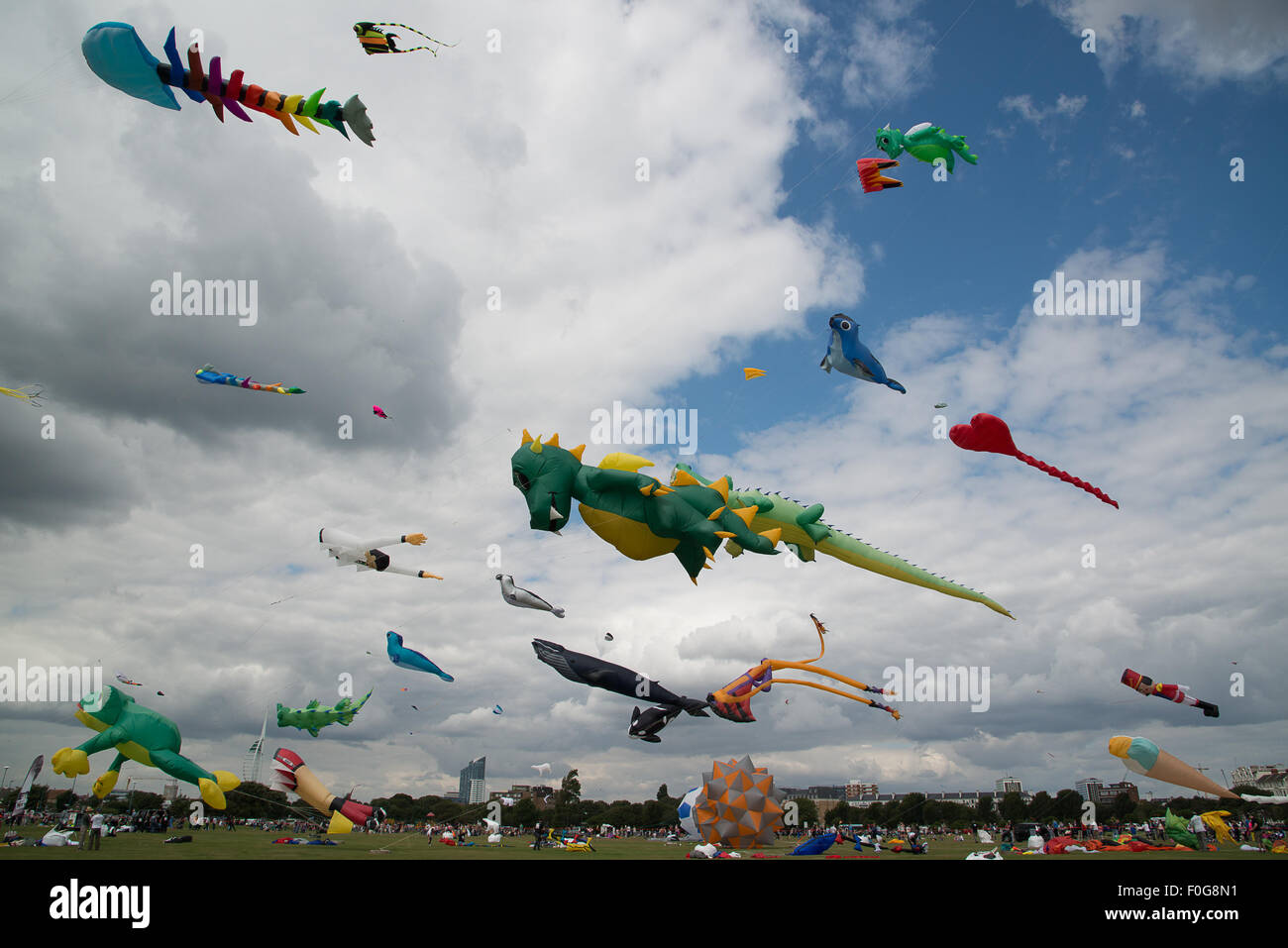 Portsmouth, UK. 15th August 2015. Southsea Common and the sky above it is filled with kites of all shapes and sizes Stock Photo