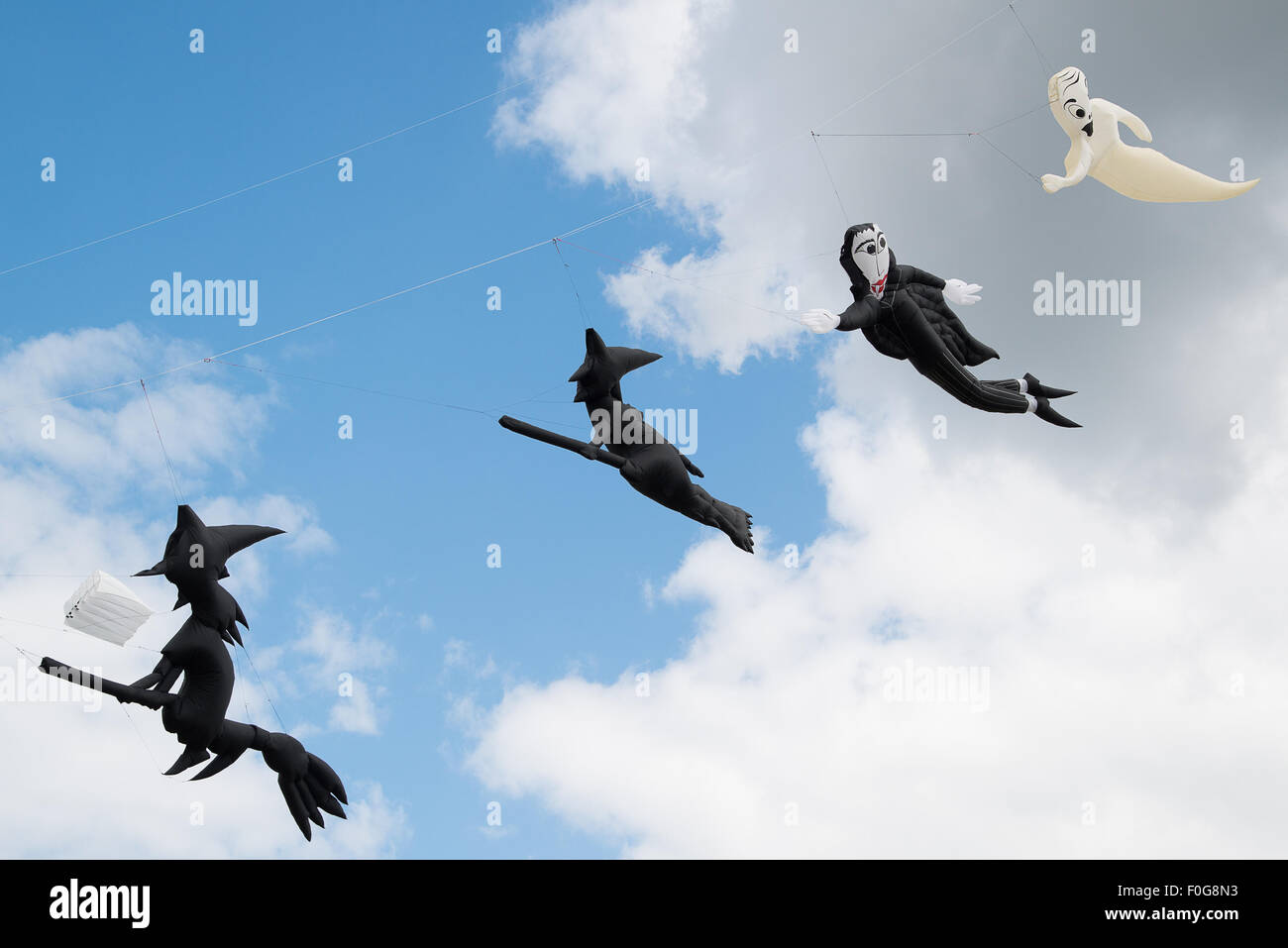 Portsmouth, UK. 15th August 2015. Witch and ghost kites fly in a line above Southsea Common at the International Stock Photo