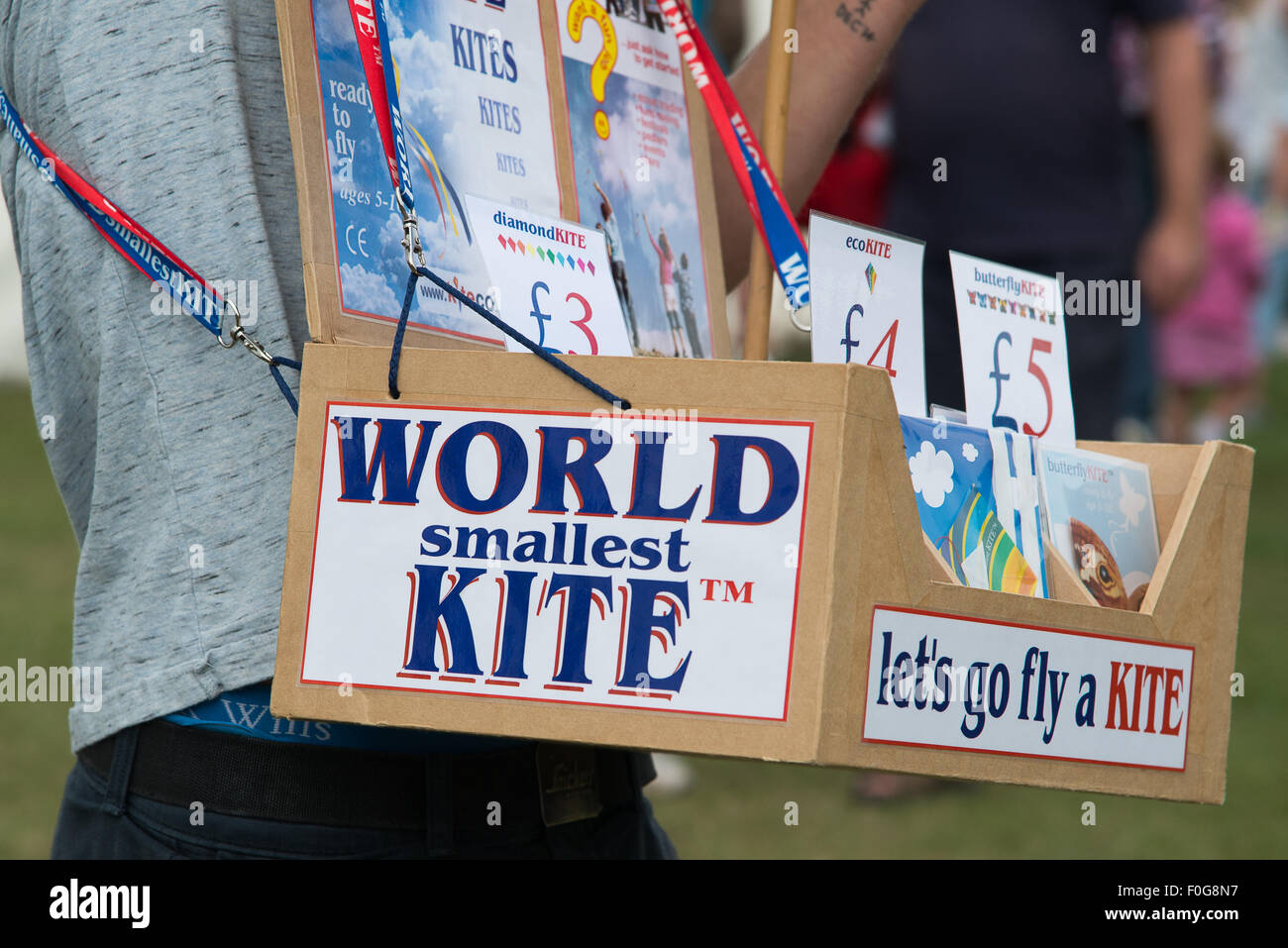 Portsmouth, UK. 15th August 2015. A trader sells the worlds smallest kite at the International Kite Festival. Credit: Stock Photo