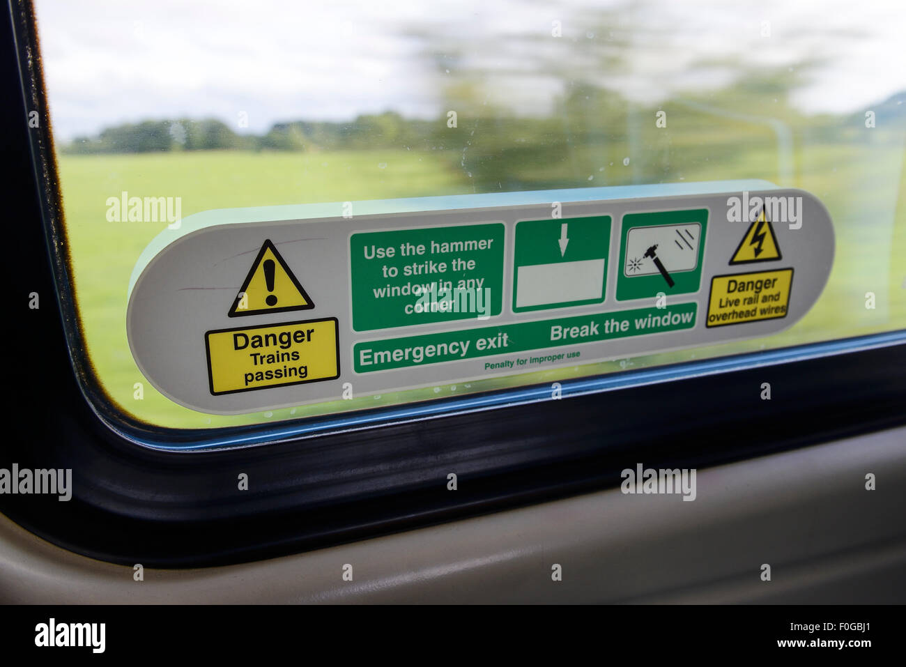 Safety instructions on the window of a Virgin train on the West Coast Main line UK - Stock Image