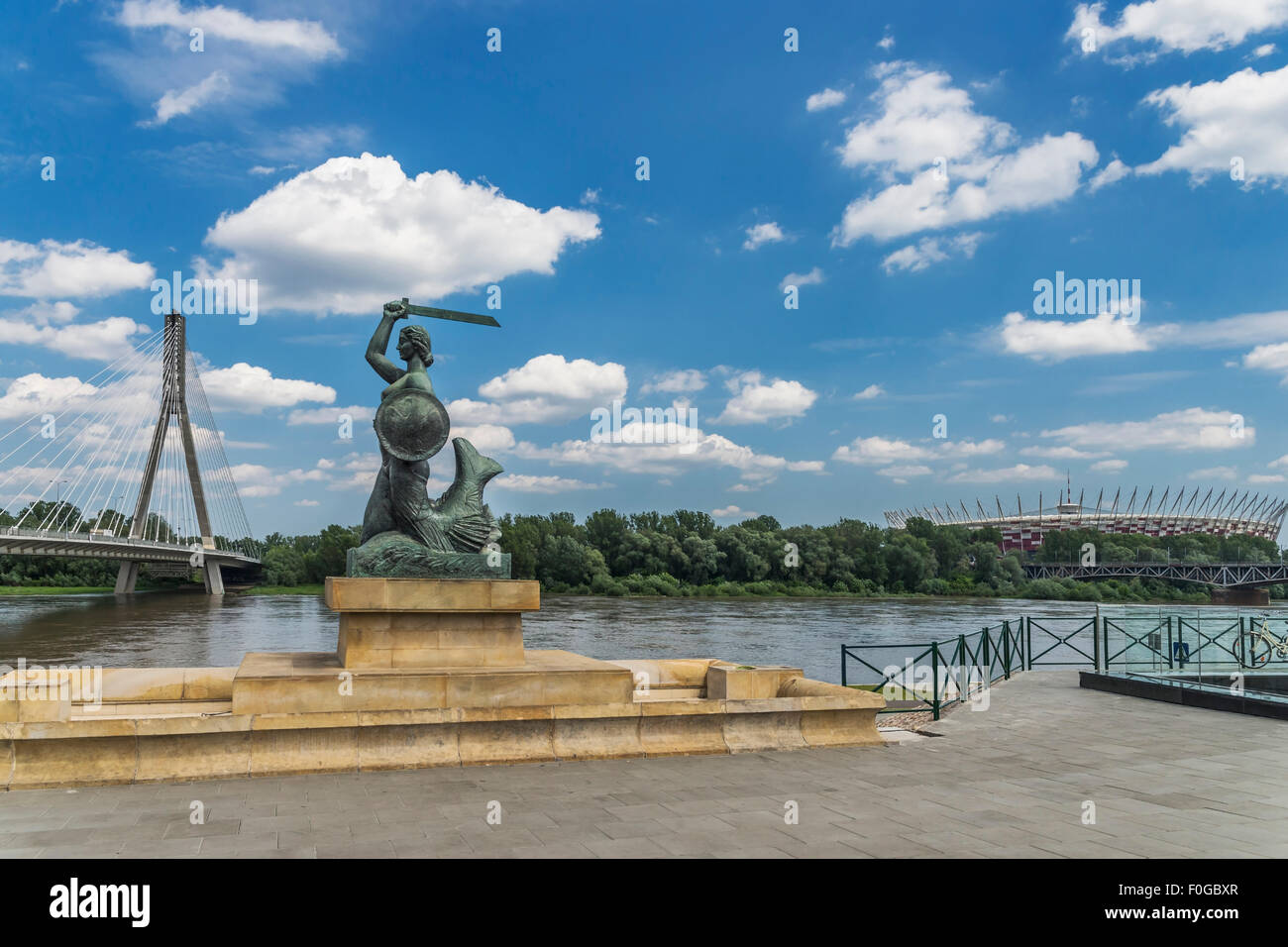 The statue of the Mermaid of Warsaw is located on the left bank of the Vistula River, Warsaw, Masovian, Poland, - Stock Image