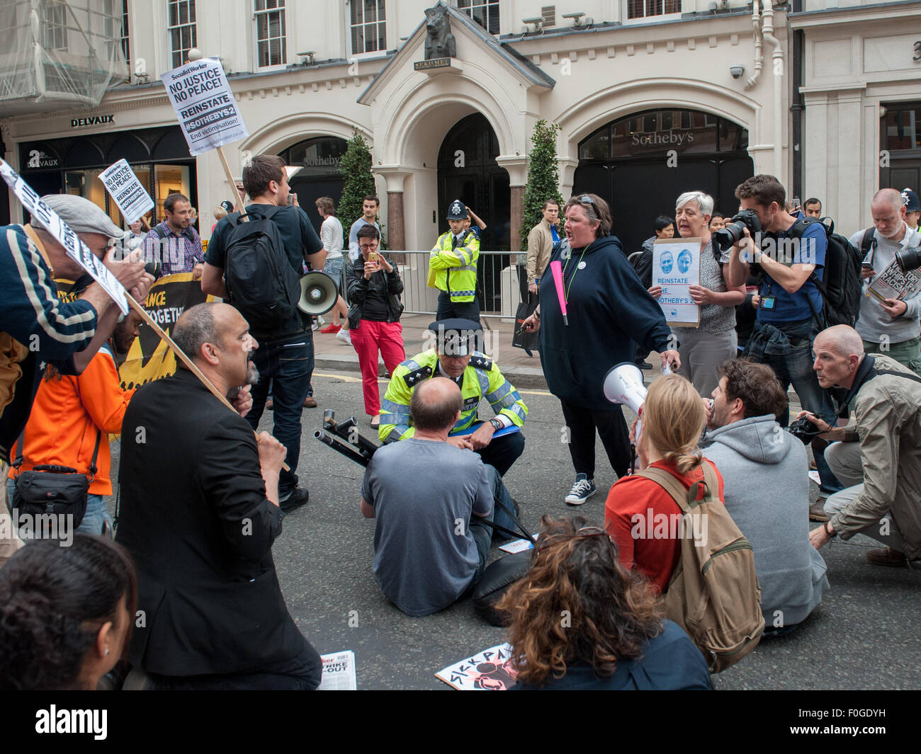 London, UK. 15 August, 2015. Activists gathered outside Sotheby's in London's New Bond Street to protest - Stock Image