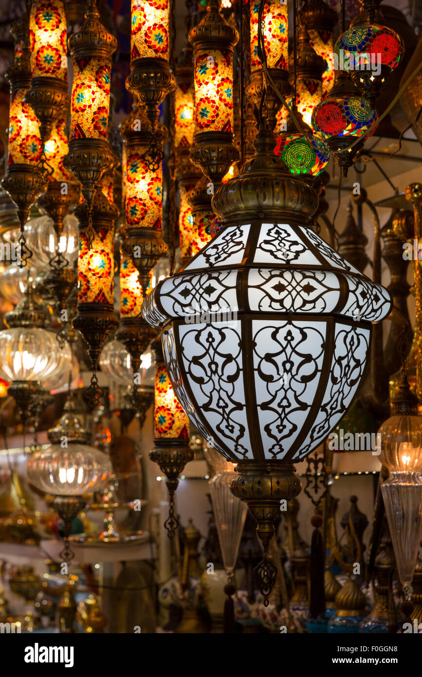 Light fixtures of diverse sizes glow at a lamp shop in the Grand Bazaar, Istanbul, Turkey. - Stock Image