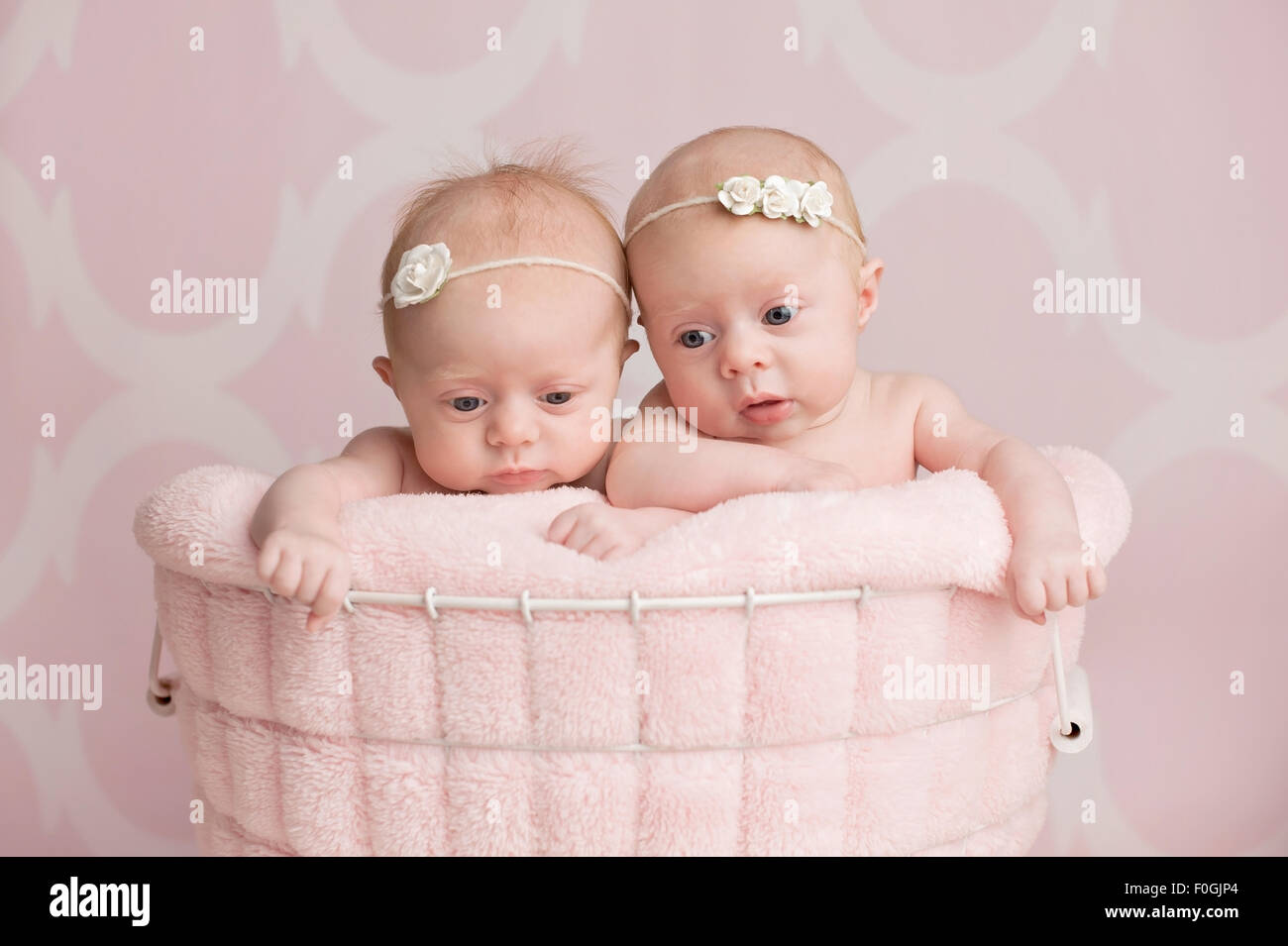 Two Twin Baby Girls Sit Stock Photos & Two Twin Baby Girls Sit Stock ...