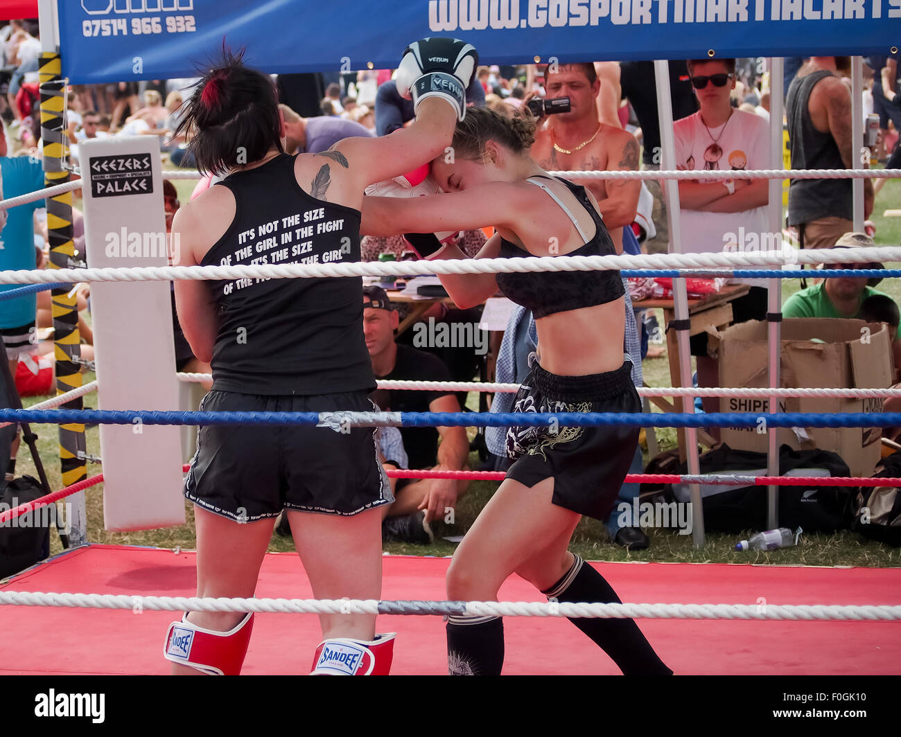 Female Muay Thai boxers, fighting in an outdoor ring Stock Photo