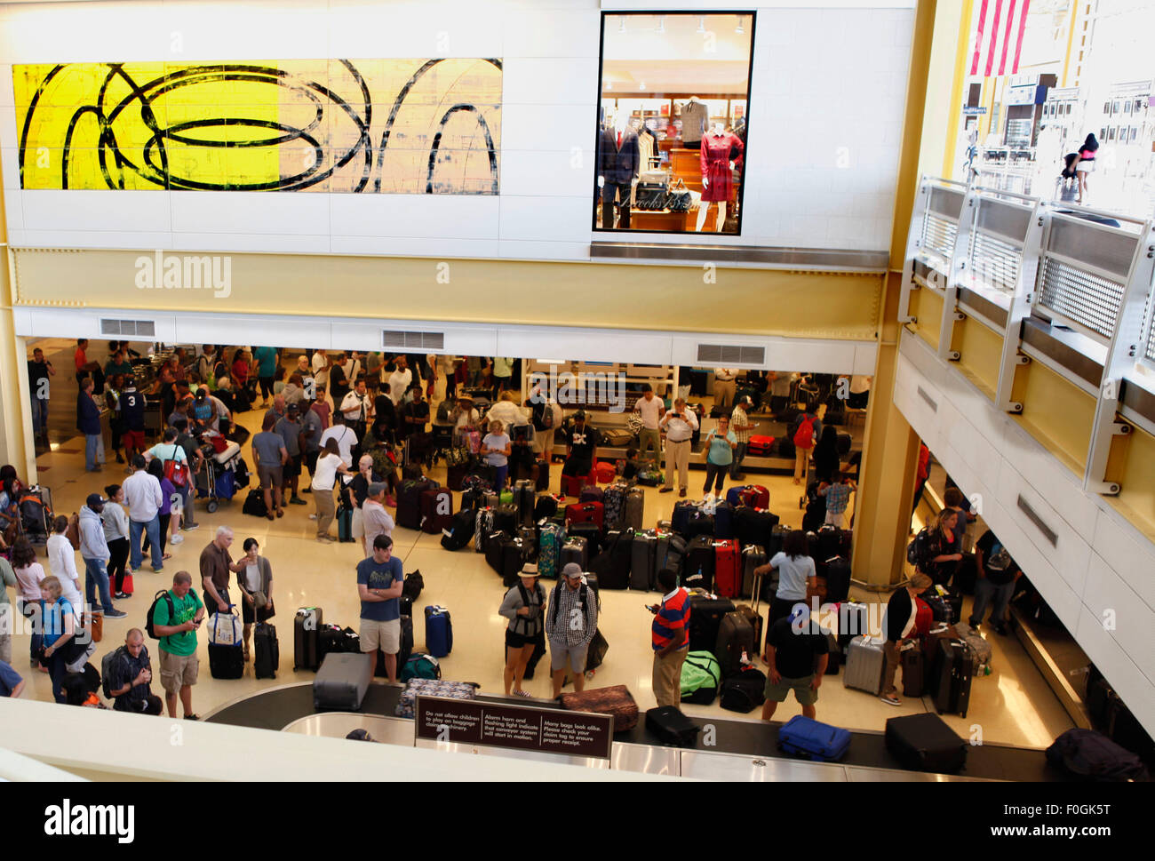 Washington, DC, USA. 15th Aug, 2015. Passengers wait to claim their baggages at Ronald Regan National Washington - Stock Image